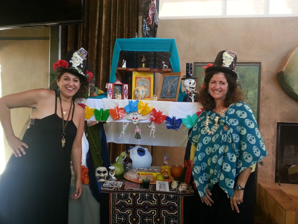 Alison Crotty, DRE, and Susan Hahm led the intergenerational Dia De Los Muertos service on Nov. 2, 2013. Here, they stand in front of the alter filled with ofrendas, or offerings.