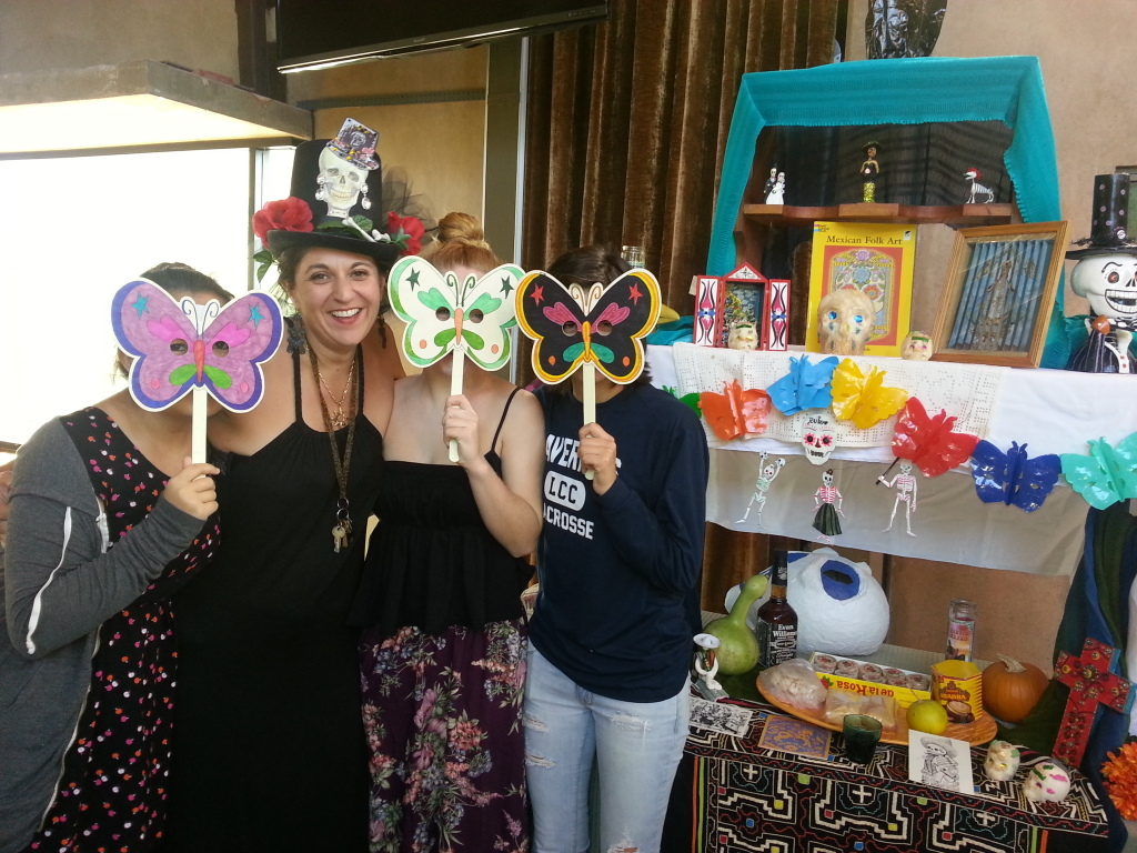 Some YRUU behind the butterfly masks they decorated. With Alison after Dia de Los Muertos intergenerational service, Nov. 2, 2013.