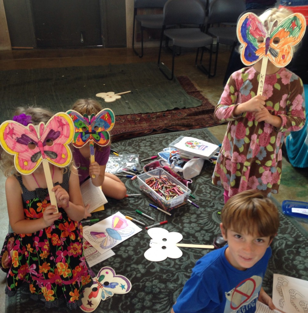 Children with their beautiful butterfly masks after the service